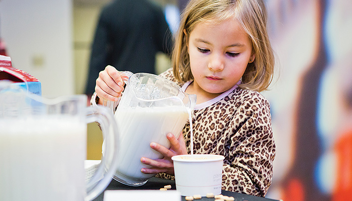 Child pouring milk