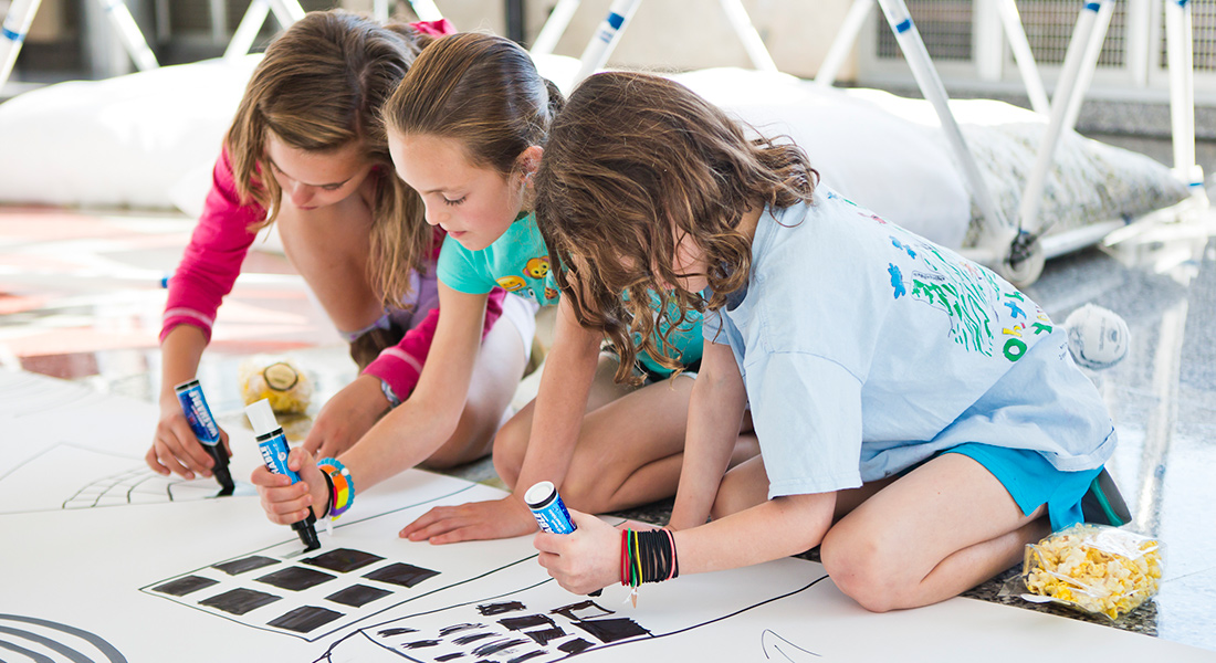 Kids participating in art making activities