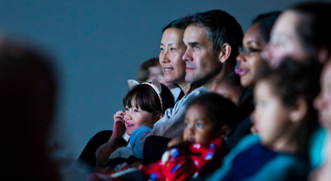 Families enjoy watching a film