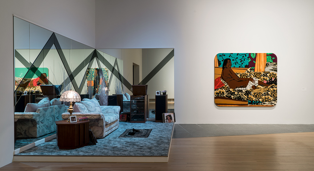 "An installation shot of artwork by Mickalene Thomas, inspired by her mother Sandra ""Mama"" Bush, as seen in the Wexner Center for the Arts Fall 2018 exhibition Mickalene Thomas: I Can't See You Without Me"