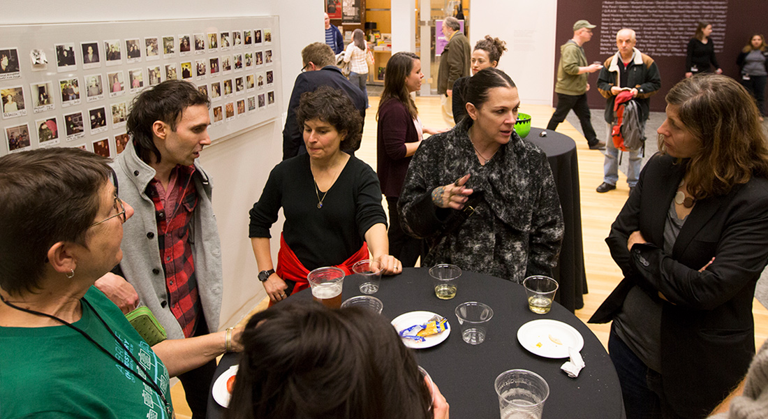 Patrons mingle at a reception at the Wex