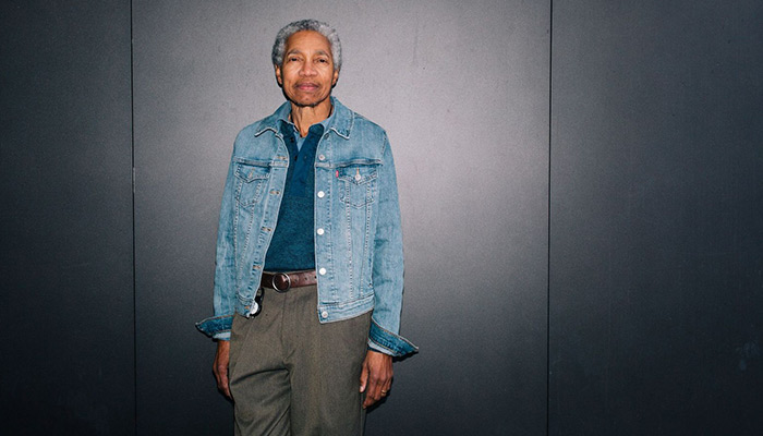 Beverly Glenn-Copeland stands in front of a gray wall